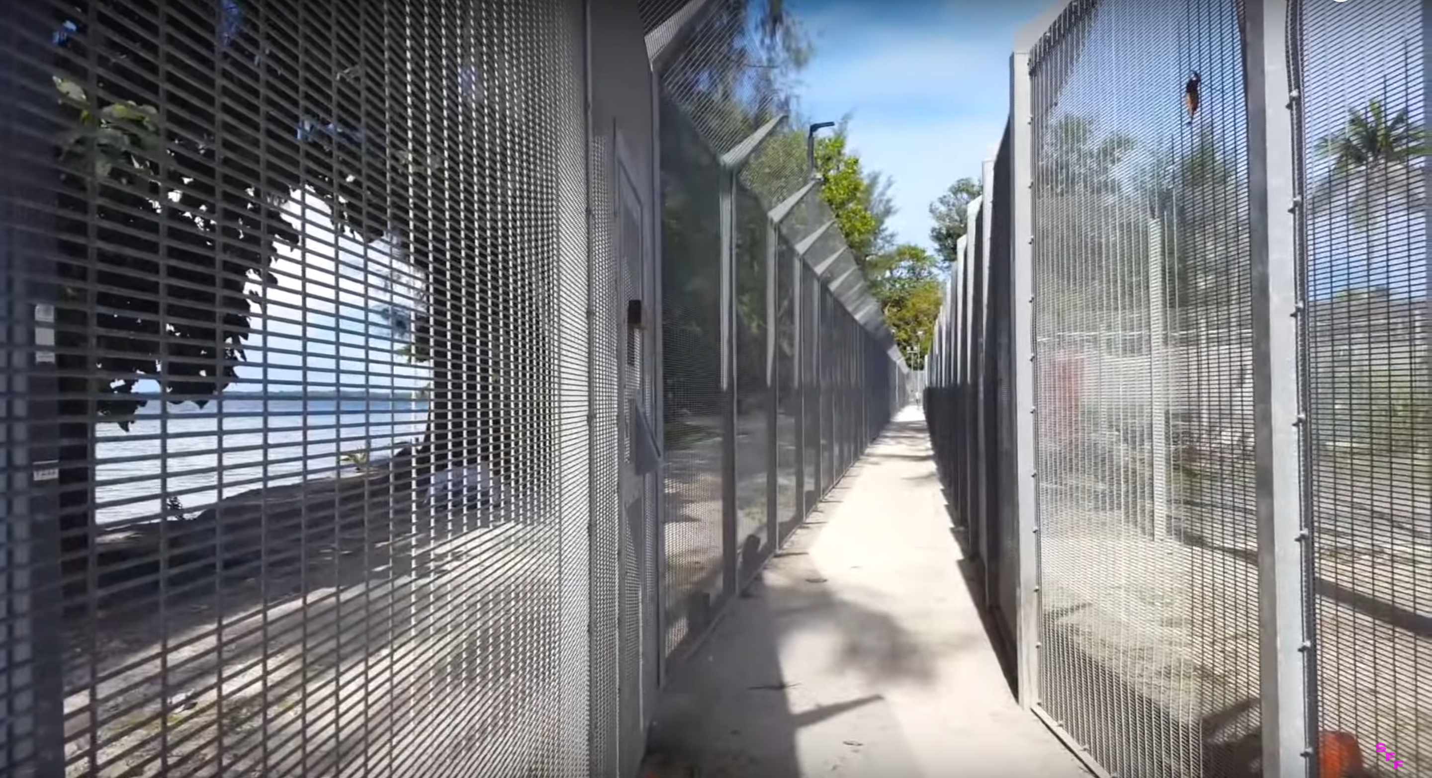 <p>Arash Kamali Sarvestani and Behrouz Boochani, <em>Chauka, Please Tell Us The Time</em> (2017), video still, depicting the fence at Manus Regional Processing Centre, before its closure and detainees were moved to other facilities on the island.</p>
